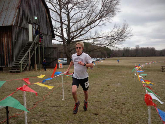 Ryan Stasiowski finishes the 2013 Patuxent 10k. Photo by: Charlie Ban