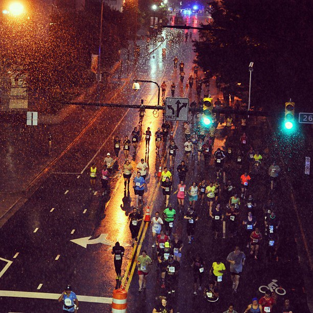 Runners traverse the rain soaked streets during the Crystal City Twilighter 5k.                                                 Photo: Lee Diehr.