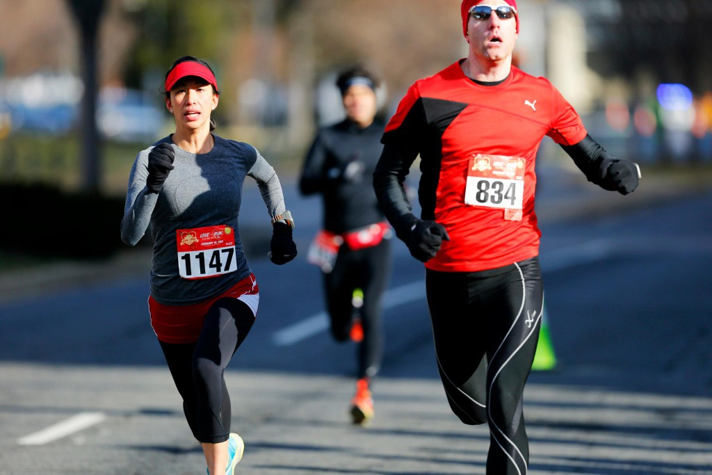 Melani Hom and Myles Matteson kick into the finish at the Love the Run You're With 5k.  Photo by Brian Knight, Swim, Bike, Run Photography