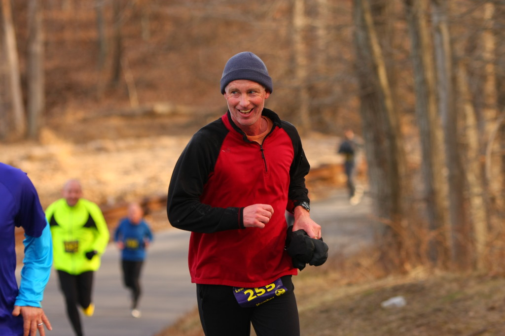 Carlton Conant of Kensington grins while climbing a hill during the Country Roads Run Five Mile. Photo by Ken Trombatore