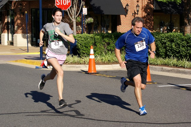 Grace Cleland chases down Chris Rini at the end of the Crime Solvers 5k. Photo: Cheryl Young