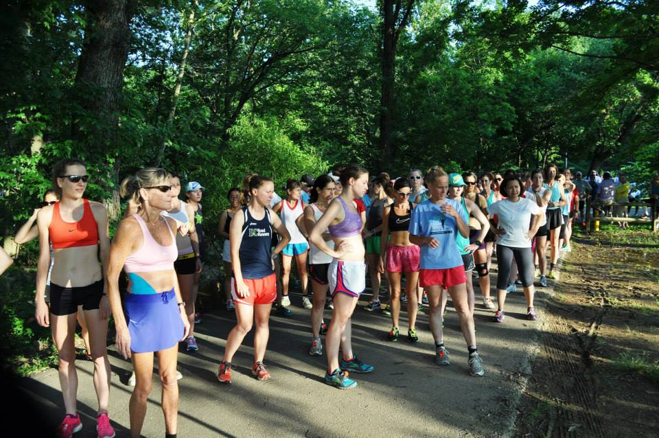 Runners take a moment to ask if they really want to put themselves through a 5k with temperatures in the 90s at the Women's Distance Festival in Bluemont Park. Photo: DC Road Runners