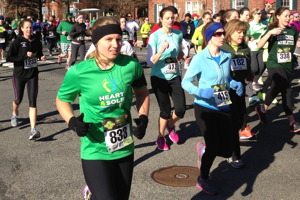 Hope Wilkes and Beth McClain head downhill in the first mile of the Four Courts Four Miler.                Photo: Charlie Ban
