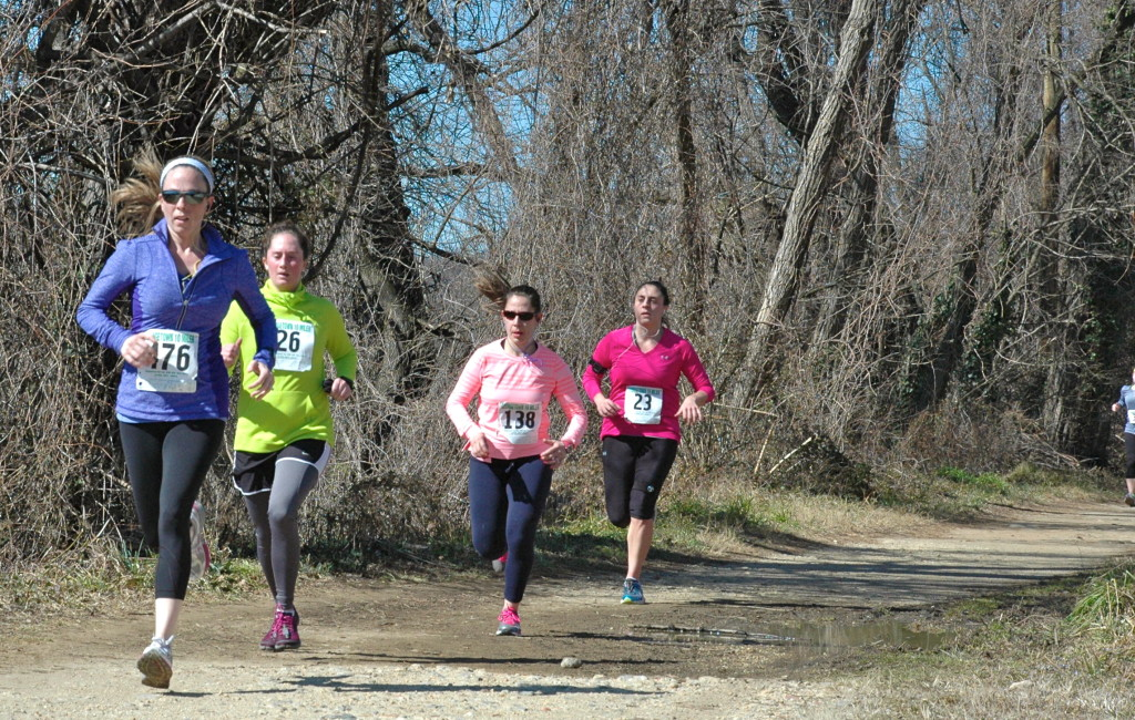 Sue Tate, Jori Beck, Christa Elza and Kelly Bauer finish up the Georgetown 10 Miler on the C&O Canal Towpath March 9. Photo: Jamie Corey