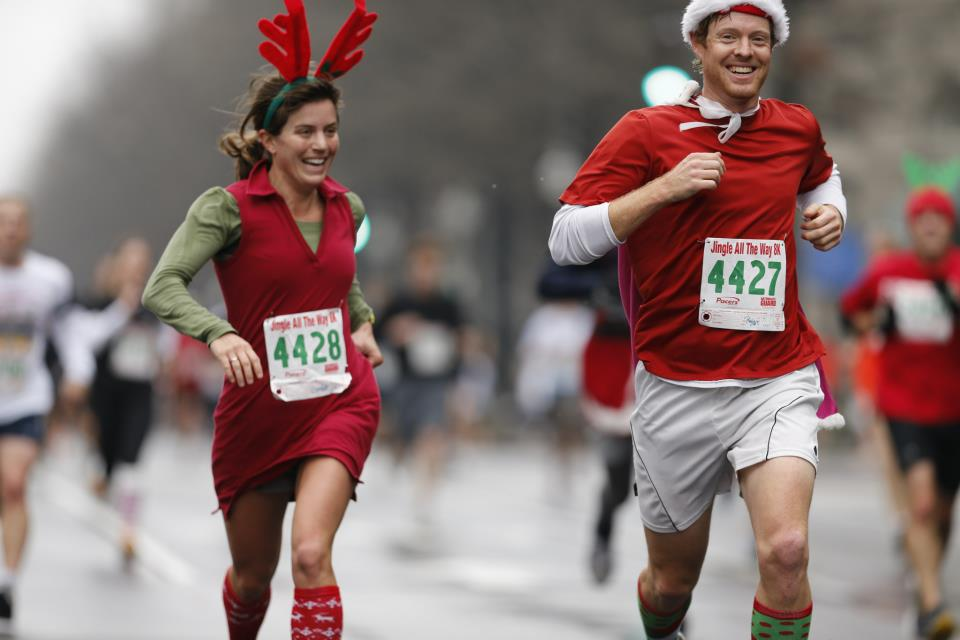 Caroline Paulsen and Ryan Porter maintain solid paces at the Jingle All the Way 8k despite some unorthodox running outfits.                                  Photos by Brian Knight/Swim Bike Run Photography