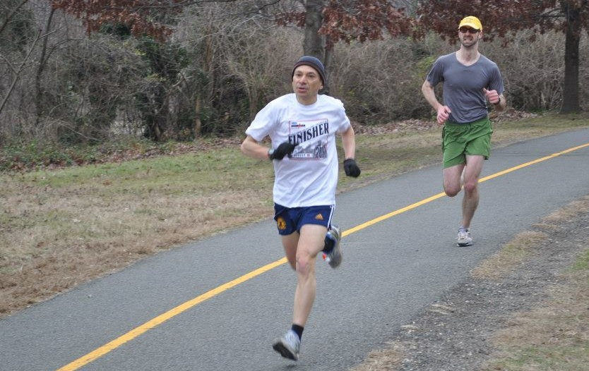 Kevin D'Amanda finishes the DC Road Runners' Predictions and Resolutions 5k on New Year's Day.    Photo by DC Road Runners