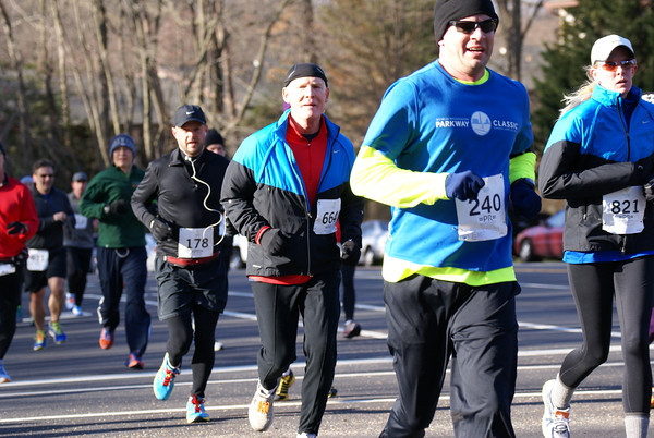 Jeff Martin, of Vienna, runs into an illuminating, but not warming, sun during the Reston 10 Miler. Photo by Cheryl Young