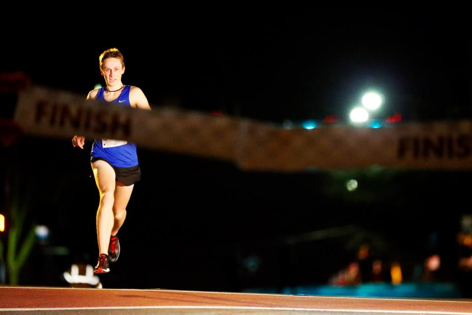 Reston's Alex Benway prepares to break the tape at the Fairfax Four Miler on New Year's Eve.                                                 Photo by Brian Knight