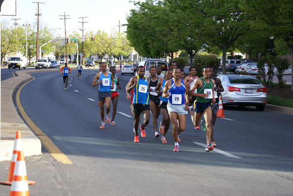 The lead pack rockets down Rockville Pike during the Pike's Peek 10k.                                          Photo: Cheryl Young