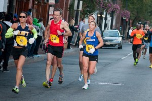 Gina Slaby (Navy) and  Emily Shertzer (Air Force) run together in mile five of the Marine Corps Marathon. Photo: Jimmy Daly