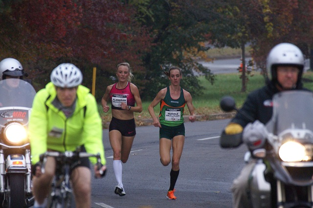 Shalene Flanagan and Molly Huddle run side-by-side approaching six miles at the .US National Road Racing Championships in Alexandria. Photo: Cheryl Young