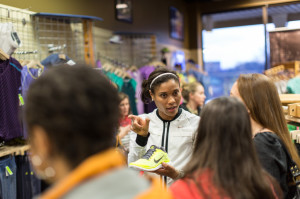 Nikeya Green shows off some shoes at Potomac River Running's Tysons Corner store. Photo:Dustin Whitlow