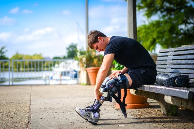 John Mullen adjusts his running legs. Photo: Sara Alepin
