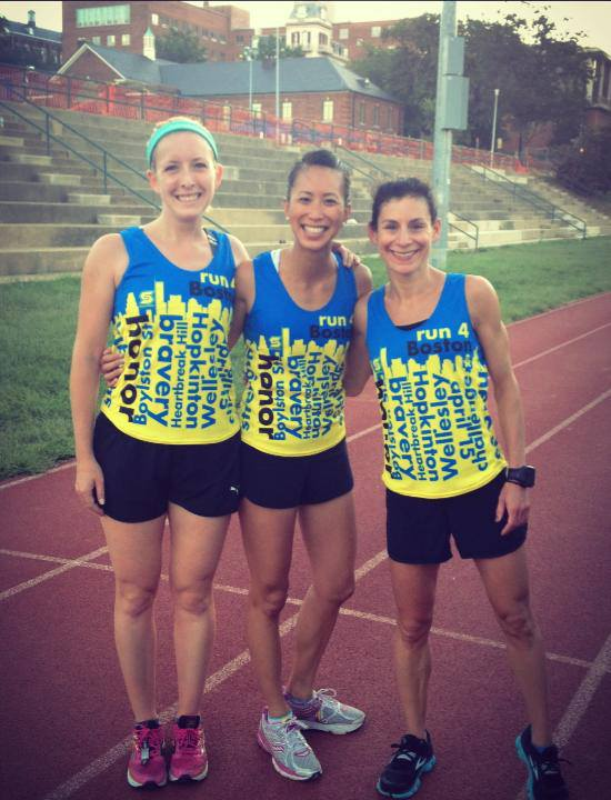 Lauren Gabler and Melani Hom show off their singlets, with FIRST LAST. Photo: Courtesy of Lauren Gabler