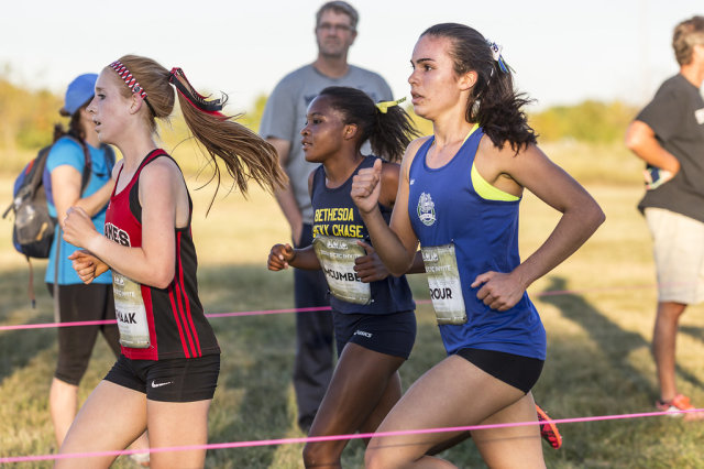 Amanda Swaak, Nora McUmber and Lucy Srour battle through the second mile in the senior girls' race at the DCXC Invitational. Photo: Dustin Whitlow