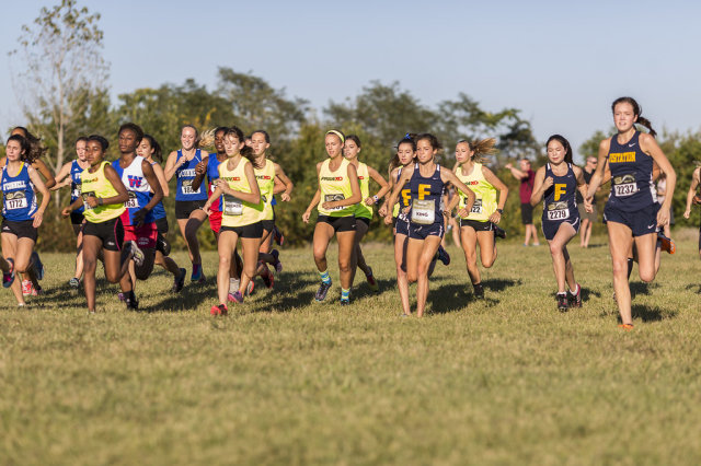 Heritage and the Field School storm the course in the junior girls' race at the DCXC Invitational. Photo: Dustin Whitlow