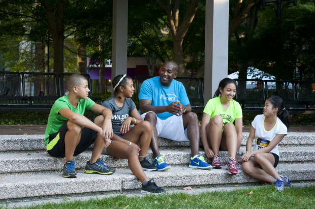 Desmond Dunham counsels his runners before the Crystal City Twilighter. Photo: Meaghan Gay/ Swim Bike Run Photography