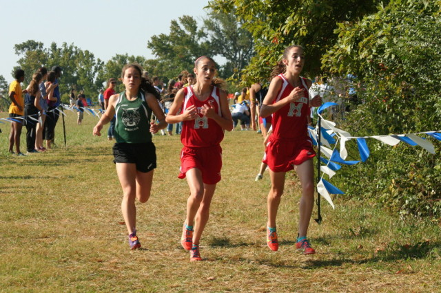 Walter Johnson's Kiernan Keller chases George C. Marshall freshmen Heather and Ashley Holt. Photo: Charlie Ban. (Note: I do not yet know which Holt is which)