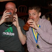 Mike Mongtomery drowns his sorrows after tearing his meniscus during the 2014 Boston Marathon and Ken Trombatore celebrates a successful race.  Photo:  Courtesy of Trombatore