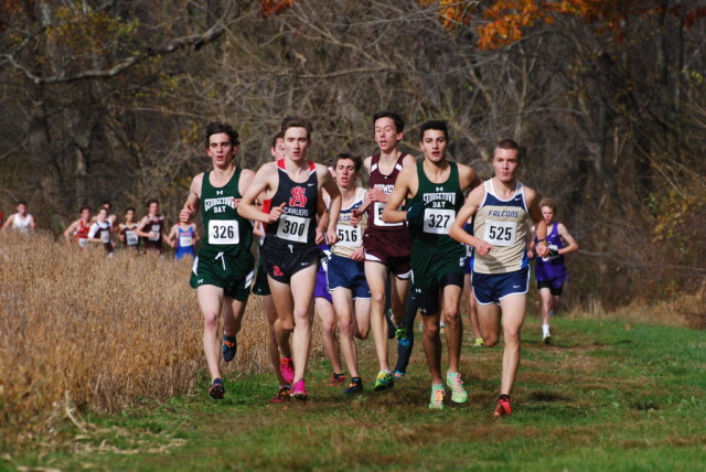The lead pack of the boys large schools race cruises through the course at Derwood, with eventual champion Jack Wavering on the right end. Photo: Dan DiFonzo