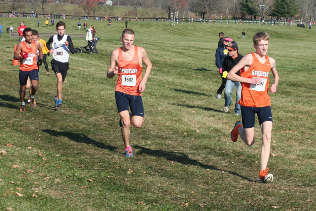 West Springfield's Andrew Lackey drags along teammates Evan Fabish and Nahom Teshome in the final stretch of the 6A boys' race at the Virginia state cross country championships. Photo: Charlie Ban