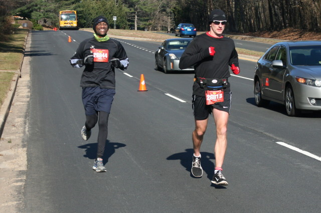 Isaac Mativo is all smiles while Tom Kalka leads the way at mile 15 of the Runners Marathon of Reston. Photo: Charlie Ban