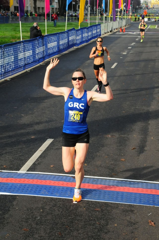 Teal Burrell crosses the finish line at the 2014 California International Marathon. Photo: Sport Photo