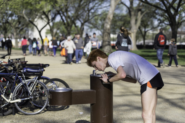 Sean O'Leary catches a quick drink at an NPS-run water fountain along the National Mall on Jefferson Drive. Photo: Dustin Whitlow/ D. Whit Photography