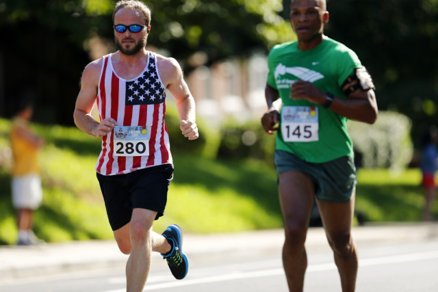 Michael McMunn (left) and Tracey Holtshirley scale Wilson Boulevard. Photo: Brian W. Knight/ Swim Bike Run Photography