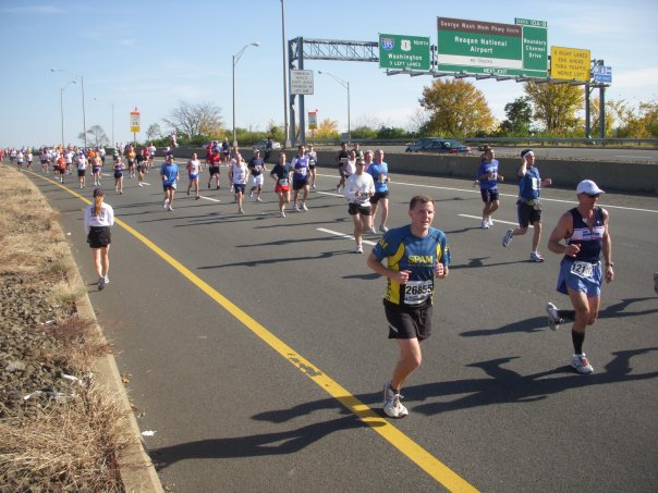 "These 2009 runners ""beat the bridge,"" crossing the 14th Street Bridge before 1:15 p.m. during the Marine Corps Marathon. Photo: Charlie Ban"