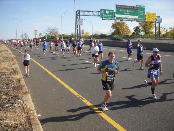 "These 2009 runners ""beat the bridge,"" crossing the 14th Street Bridge before 1:15 p.m. during the Marine Corps Marathon. Photo: Charlie Ban"