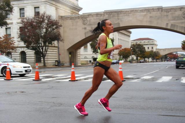 Jenny Mendez Suanca heads toward the 20 mile mark. Photo: Steve Laico