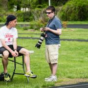 Kevin Milsted (standing) chats with Albert Einstein coach Eric DaSilva. Photo: Marleen Van den Neste