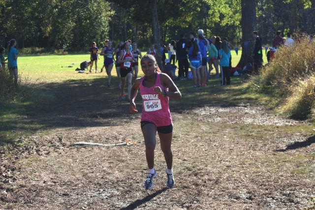 Weini Kelati gets away from the chase pack, which included Heather Holt, Kate Murphy, Taylor Knibb and Sarah Daniels a half mile into the Glory Days Invitational. Photo: Charlie Ban