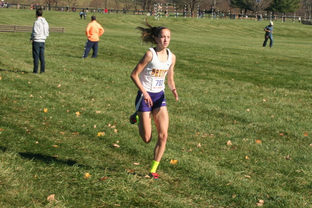 Kate Murphy cruises in for her first cross country state title, in the 6A division. Photo: Charlie Ban