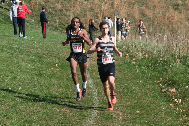 Rohann Asfaw right on Eric Walz's heels at the Maryland 4A championships. Photo: Charlie Ban