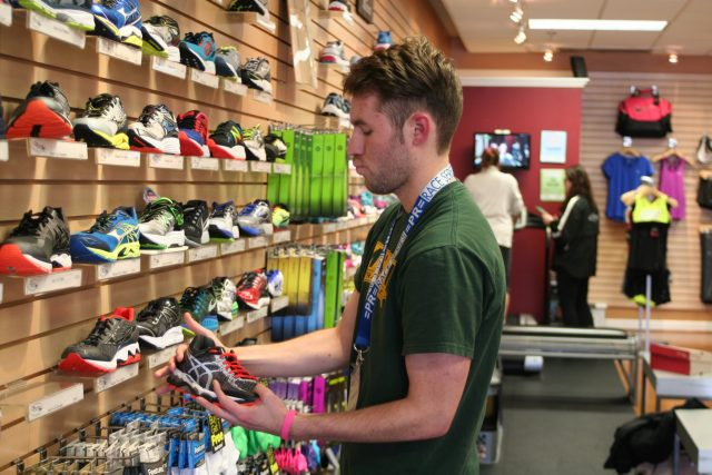 Manager Aaron McCray shows off the Potomac River Running - Burke store. Photo: Charlie Ban