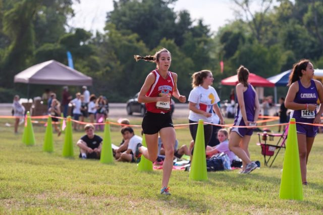 Heather Holt has the DCXC Invitational course to herself during the junior race, during which she set the meet record in 16:56 for 3.07 miles. Photo: Dustin Whitlow/DWhit Photography