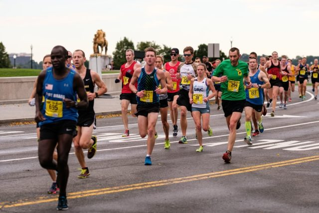 Stephanie Riech navigates the crowd nearing the second mile mark at the Army Ten-Miler. Photo: Dustin Whitlow/DWhit Photography