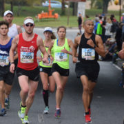 Perry Shoemaker (90) runs mile nine of the 2016 Marine Corps Marathon. Photo: Charlie Ban