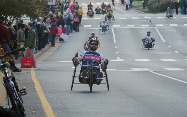 Hand-crank cyclists lead off the 2013 Marine Corps Marathon. Photo: Jimmy Daly