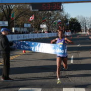 Hiwot Gebrekidan crosses the finish line at the 207 Cherry Blossom Ten Mile. Photo: courtesy of Keith Peters