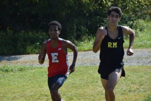Edison's Yared Mekonnen and Richard Montgomery's Joachim El-Masry with a quarter mile to go. Photo: Charlie Ban