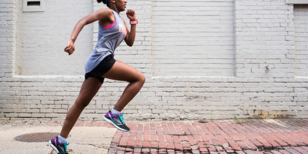 McKinley Tech High Schooler, Ruth Tesfai, runs through the streets of DC to train for her cross country competitions.  Photography by Joy Asico