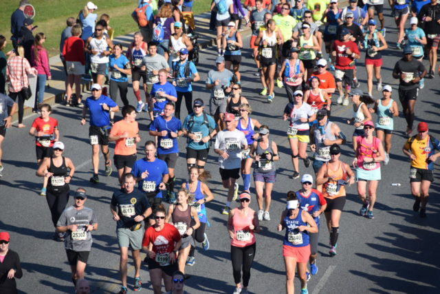 Runners approach the 10 mile mark in the 2017 Marine Corps Marathon. Photo: Charlie Ban