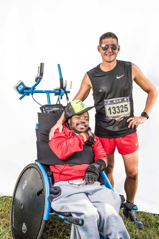 """Photo By Doug Stroud Team """"Big D and Marc"""", Marc Hodulich, (37), of Atlanta, GA and Don Tavious Ridley in the in the recumbent wheel chair participated in the 2017 Marine Corps Marathon and their first marathon as team together finishing with a time of 3:58:41. Big D, """"I asked Marc if we could do another marathon together during the race, I had such a good time"""", Marc responded- rather hoarsely, laughingly, """"Let's finish this one first"""". Big D went on to say that, """"This is the most fun I've had in a long time, I hope we can go to other countries like Canada. I want to do bigger and better places""""."""