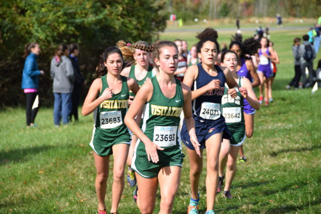 Michaela Kirvan (center) leads a pack through mile 2 of the D.C. state championships. To her left is Brennan Dunne , to her right is Zoe Edelman. Photo: Charlie Ban