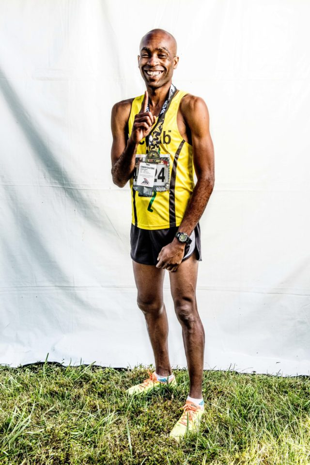 """Photo By Doug Stroud Denzel Ramirez of Phoenix, AZ took top honors in the 2017 Marine Corps Marathon 10K finishing in first place for men with a time of 32:17. """"I feel great, that is the fastest I have ever run in a 10K"""". """"It's more of community thing for me, I use it [sic] running to enhance my professionalism, I don't have an actual goal, I do it for fun like any other person, it's form of dedication, to help clear your mind and your soul."""