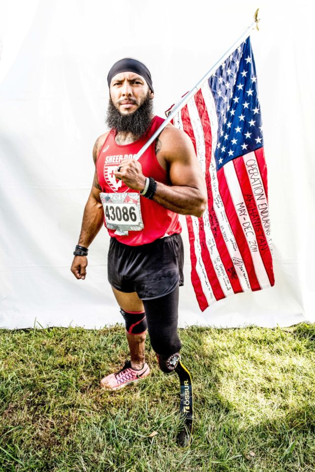 """Photo By Doug Stroud Jose Louise Sanchez retired Marine Corps of ten years a veteran of Iraq and Afghanistan from San Antonio, TX finished the 2017 Marine Corps Marathon 10K with a time of 54:38. During a ground patrol in October of 2011, Sanchez stepped on an IAD losing his left leg. When asked about his life, Sanchez responded, """"I try to motivate and inspire others to push their own limits, push through adversity, and rise above"""". Sanchez ran his first marathon, the Marine Corps Marathon in 2015, the Boston Marathon in 2016 and 2017 and the 2017 Marine Corps Marathon 10K."""
