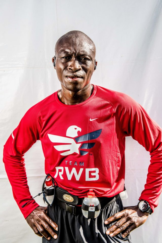 """Photo By Doug Stroud William Smith from Sierra Leone, West Africa now resides at Andrews Air Force Base ran his first Marine Corps Marathon in 3:25:22. Not being familiar with the course Smith said he needed to manage his speed, """"I'm glad with my time, I've done better than any of my other marathons, I'm glad with my time"""". Running for Red White and Blue, """"Is one of the groups I admire for the fact of what they do for the veterans and that is I decided to run on them today"""". Smith will be running the Philadelphia Bell Marathon next month, the half on Saturday and full on Sunday."""